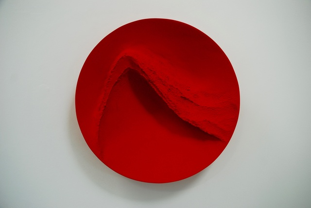 Red Wind, pigment on carved wood, 54 cm diameter